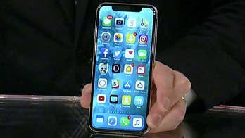 Lance Ulanoff, chief correspondent for mashable.com, demonstrates features on Apple's new smartphone which went on sale on Friday.