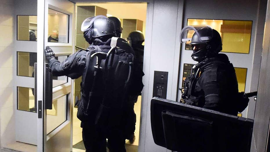 Terror raids under way outside Paris, France