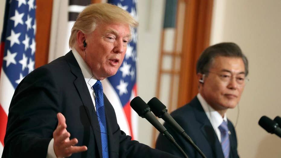 Trump projects message of unity in South Korea