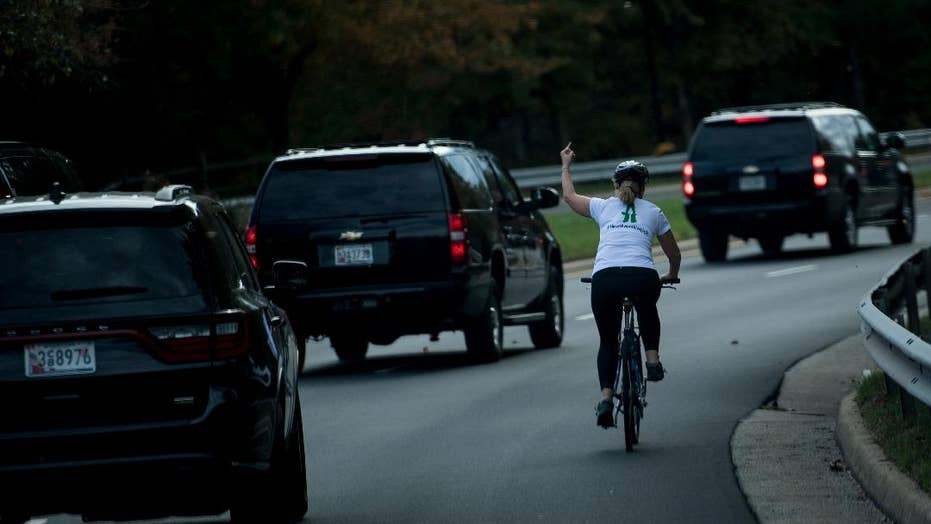Woman fired after viral photo of her giving Trump the finger