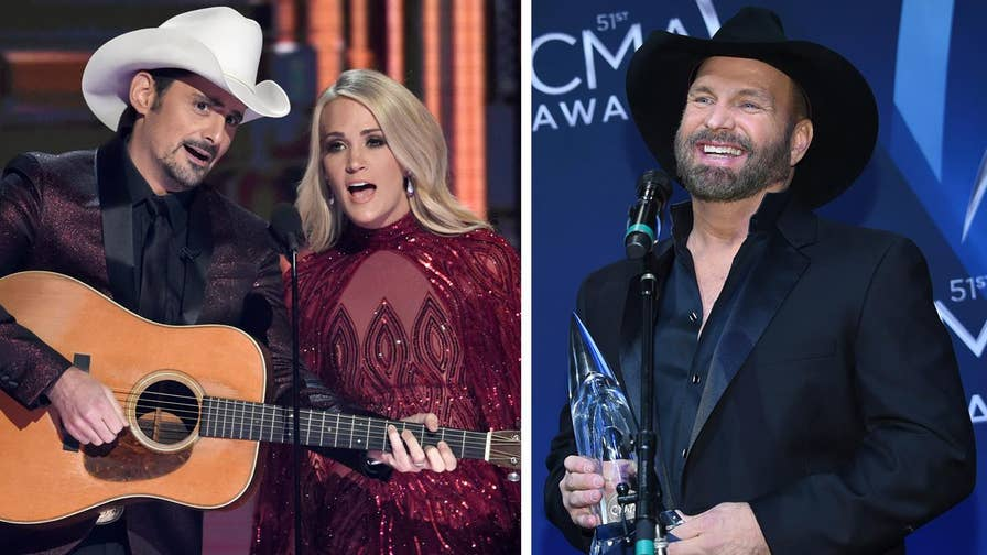 Fox411 Country: While the 51st Annual CMA Awards may have started on a somber note, hosts Carrie Underwood and Brad Paisley quickly took to mocking Trump, while Garth Brooks took home Entertainer of the Year.