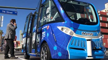 An automated driverless shuttle bus debuts in Las Vegas and on the same day a semi-truck backs up into it.