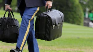 The president of the United States is accompanied by a suitcase called the 'nuclear football' at all times. What is it?