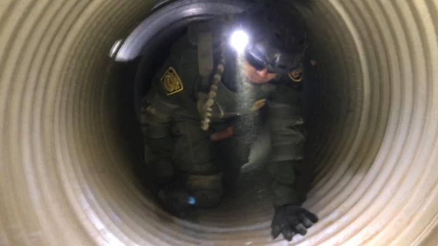 Border Patrol agents rescue an illegal with a broken ankle stuck in a storm drain