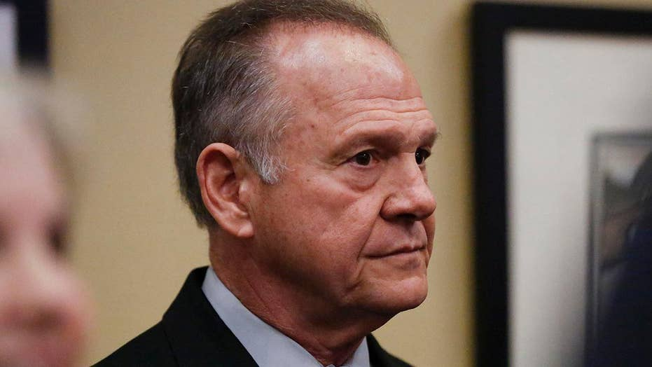 Roy Moore remains defiant as fifth accuser goes public