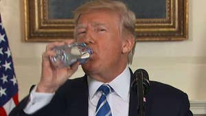 President takes break from recapping Asia trip to quench thirst with bottled water.
