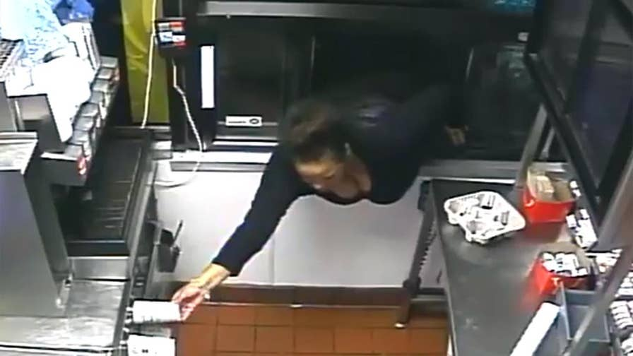 Raw video: Suspect caught on surveillance video in Columbia, Maryland McDonald's stealing money and food.