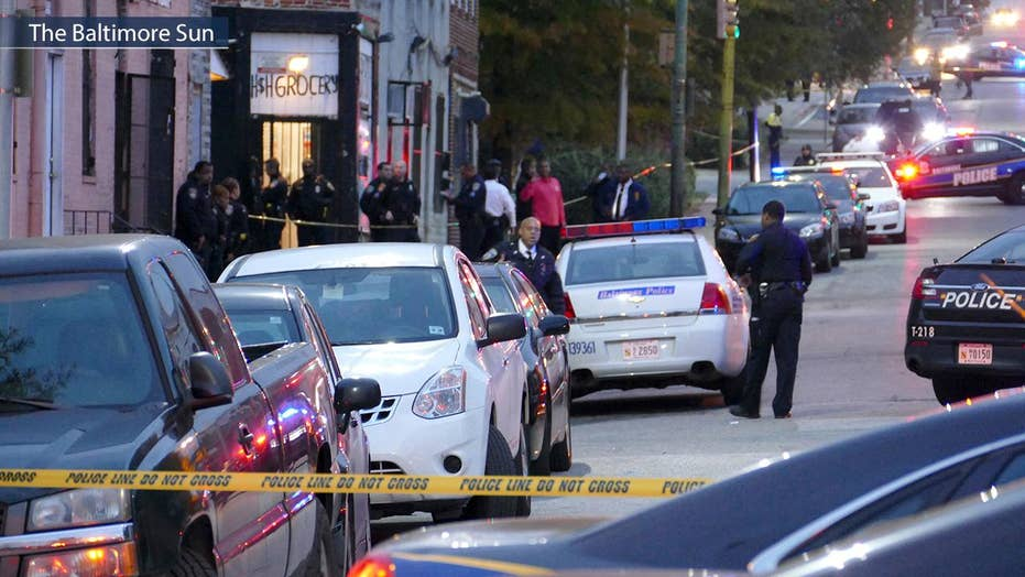 Manhunt for gunman after Baltimore detective shot in head
