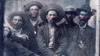A grainy 19-century photo of Billy the Kid and his killer Pat Garrett, bought at a flea market for $10, could potentially be worth millions of dollars.