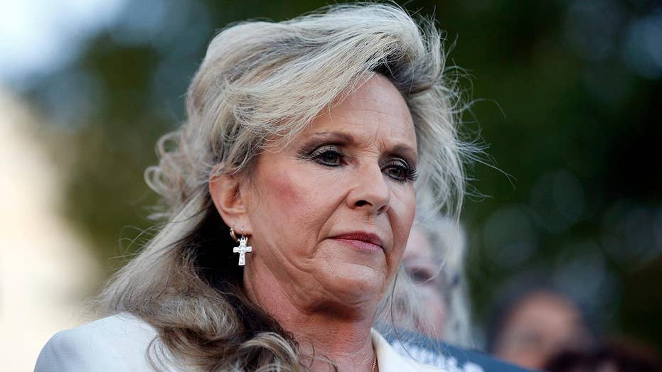 Kayla Moore: My husband will not step down