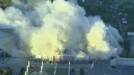 One of America's largest domed stadiums was imploded Monday morning as nearly 5,000 pounds of explosives blasted the Georgia Dome to smithereens, sending a massive plumes of smoke into the air.