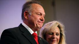Doug Jones, the Democratic nominee in Alabama's heated Senate race, hammered Republican rival Roy Moore in a new web video that features the photos and names of the women who have accused him of sexual misconduct.