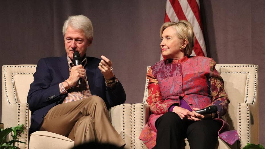 Clintons return to the stage amid Dems civil war