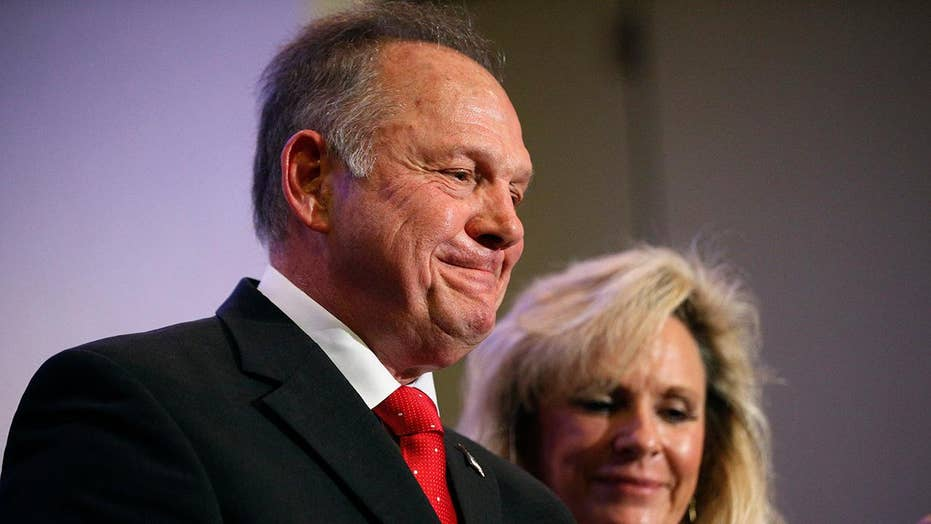 Roy Moore attacks his opponent as an accuser speaks out