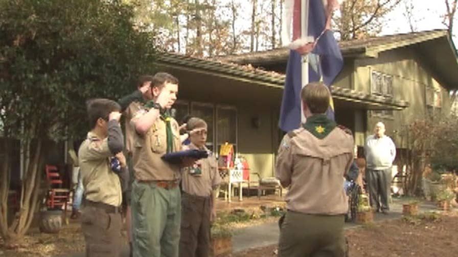 Retired naval commander honored to have assistance from the scouts.