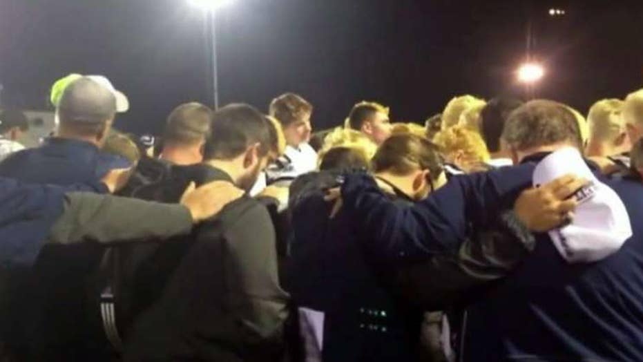 Atheists claim coach broke the law by praying with team