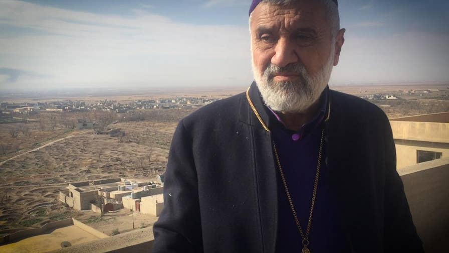 Father Afram of the 133-year-old St. George Cathedral in Iraq shows Fox News how ISIS destroyed his church and Christian imagery throughout the community.