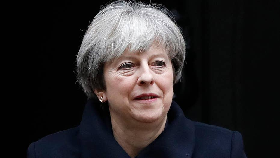 Two men accused of plotting to assassinate British PM May