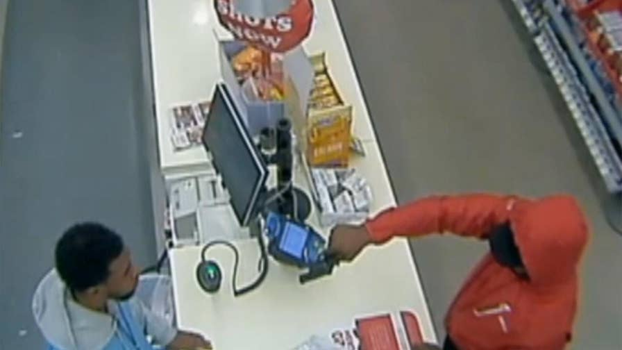 Raw video: Thief in Florida flees after store clerk stares back expressionless during armed robbery attempt.