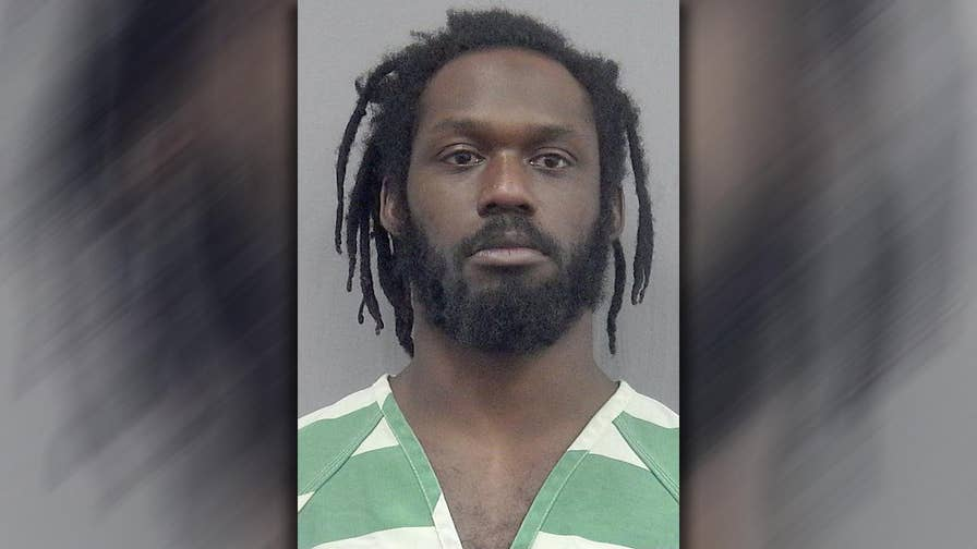 Wrestler charged for violence against wife