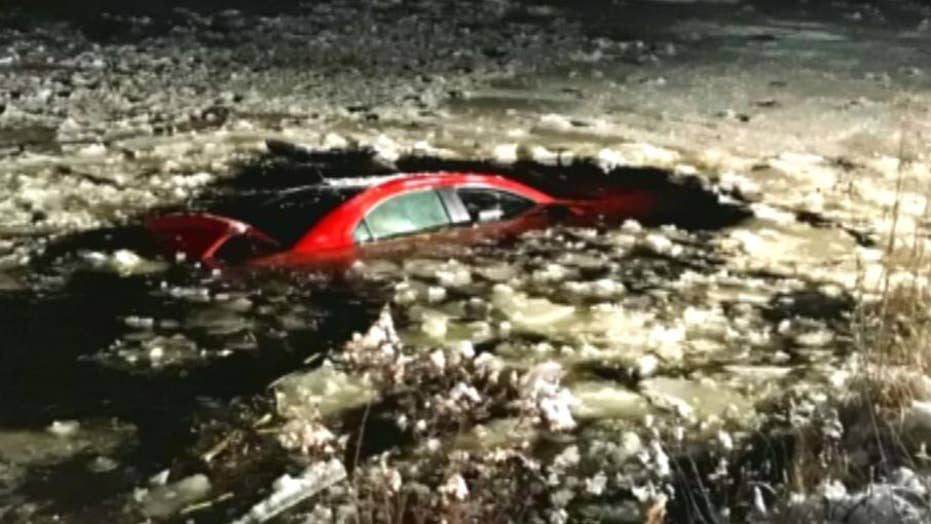 Man rescued after car plunges into frozen pond