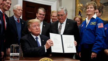 President Trump signs Space Policy Directive 1 at the White House, whose the goal to get astronauts back to the Moon and eventually to Mars follows recommendations from the National Space Council which is overseen by Vice President Pence.