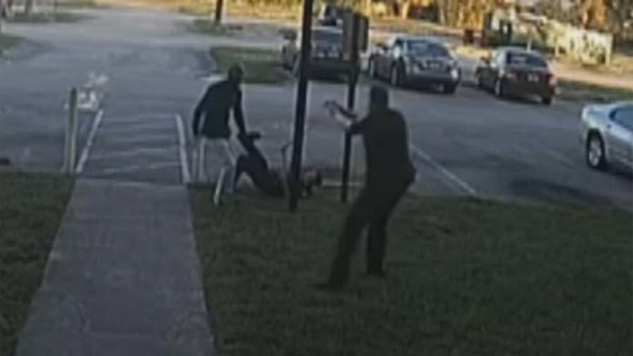 Raw video: Florida police release surveillance footage from fatal shooting after unarmed man attacked deputy.