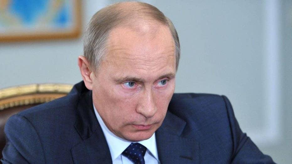 Putin visits Syria, announces partial troop withdrawal