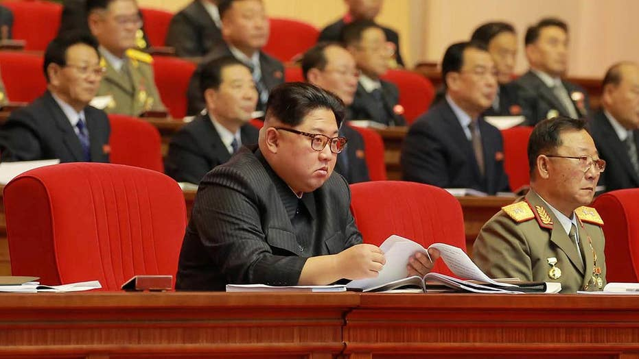 New images show Kim Jong Un with missile scientists