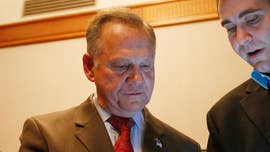 President Trump on Friday called on Roy Moore to throw in the towel in the Alabama Senate race he lost to Democrat Doug Jones on Tuesday following a bruising campaign.