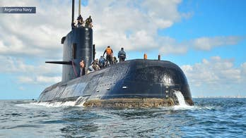 Sister of missing sailor claims the doomed Argentinian submarine was being chased by a British helicopter and Chilean ship shortly before disappearing.