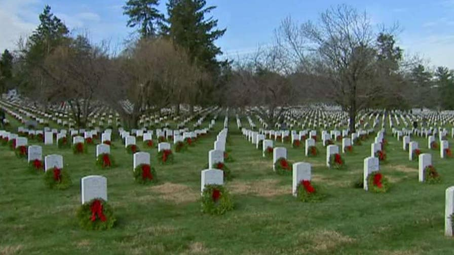 Volunteer group works to honor fallen heroes.