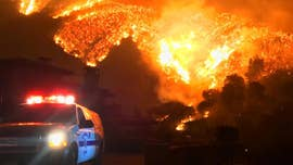 Strong winds drove one of the biggest wildfires in California's history toward Santa Barbara and the nearby wealthy enclave of Montecito Saturday, prompting residents to flee as authorities issued new evacuation orders.