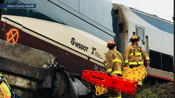 Greg Mukai says drivers ran forward to help victims of Amtrak train 501, notes the scene was eerily quiet.