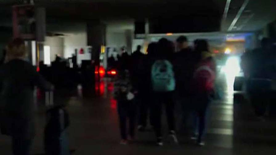Passengers left in the dark for hours at world's busiest airport.