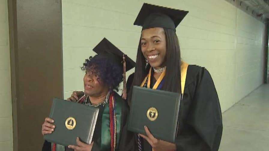 Belinda and Karea Berry graduate from Chicago State University with degrees in business and criminal justice.