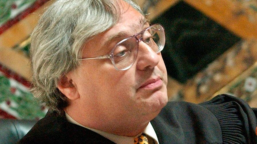 Alex Kozinski says battles over the accusations would not be good for judiciary.