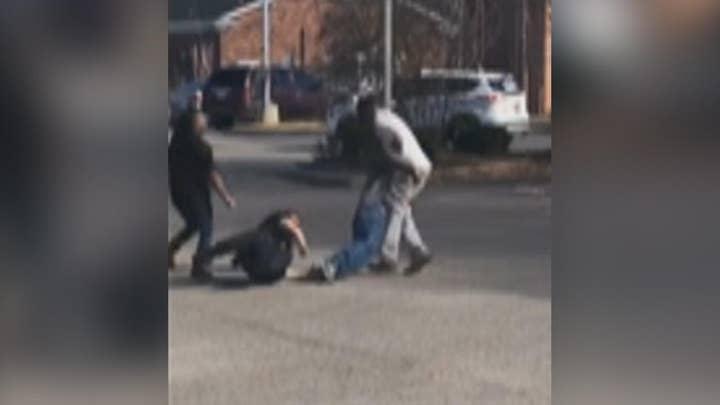 Civilians help cop take down hostile suspect