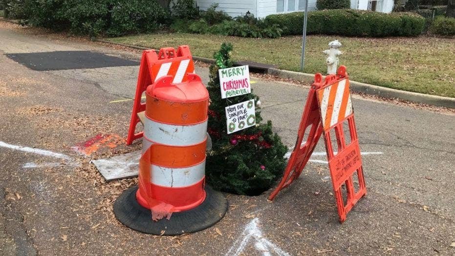Christmas tree in pothole draws attention to crumbling roads