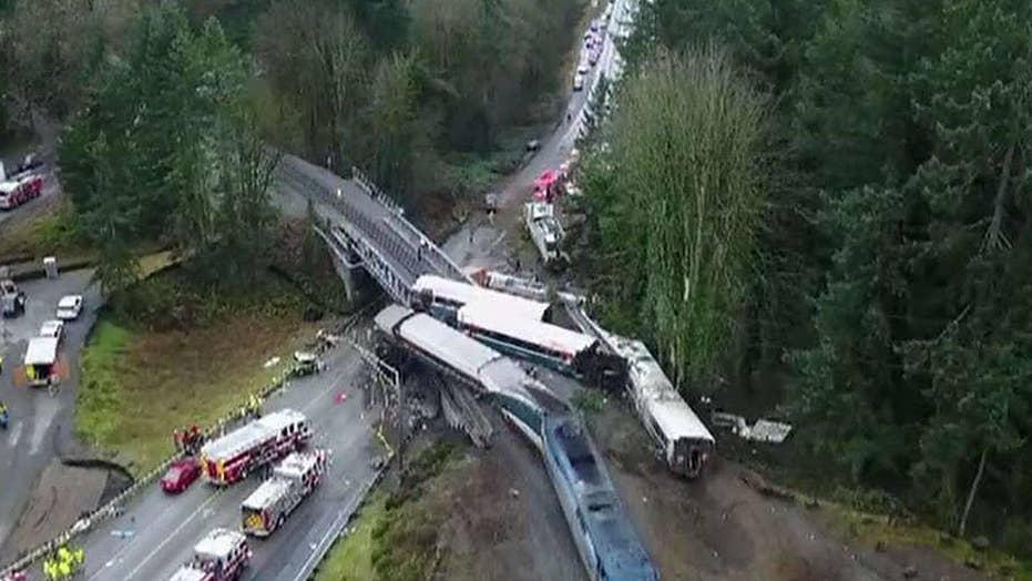 Investigators focus on speed, distractions in Amtrak crash