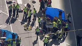 At least 14 people were injured Thursday when a white SUV plowed into a crowd of pedestrians in Melbourne, Australia. Police said they had two men in custody, including the driver of the vehicle.