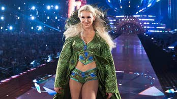 WWE superstar Charlotte Flair reflects on lessons learned from her father Ric Flair inside a new tell-all 'Second Nature.'