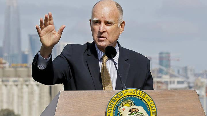 Gov. Brown pardons two immigrants awaiting deportation