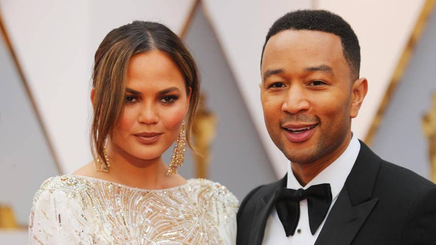Chrissy Teigen and husband John Legend tried to make the best of a horrendous 8-hour plane ride after being turned around mid-flight because an unknown person was found on board.  Pictures with passengers, Yoda and ramen all made an appearance as the supermodel live-tweeted her entire ordeal.