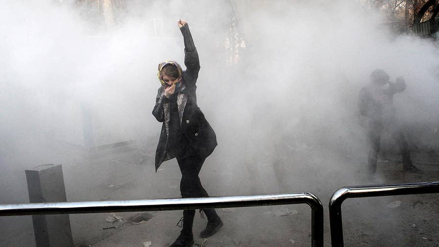 At least 12 people killed, hundreds arrested in anti-government protests in Iran; Conor Powell reports from Jerusalem.