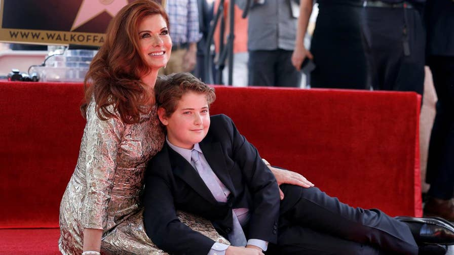Fox411: Debra Messing was blasted by the mother of a wounded veteran for praising her son's protest of the national anthem.