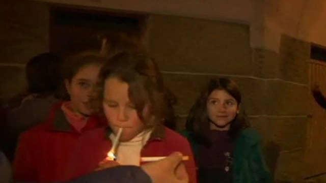 Children encouraged to smoke cigarettes at festival