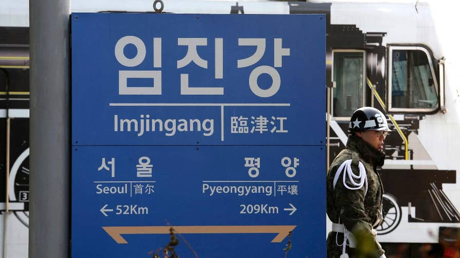 North and South Korean officials will meet at border village within the DMZ will hold talks for first time since December 2015; a spokesman for the South Korean government says talks could cover more than just the upcoming Olympics.