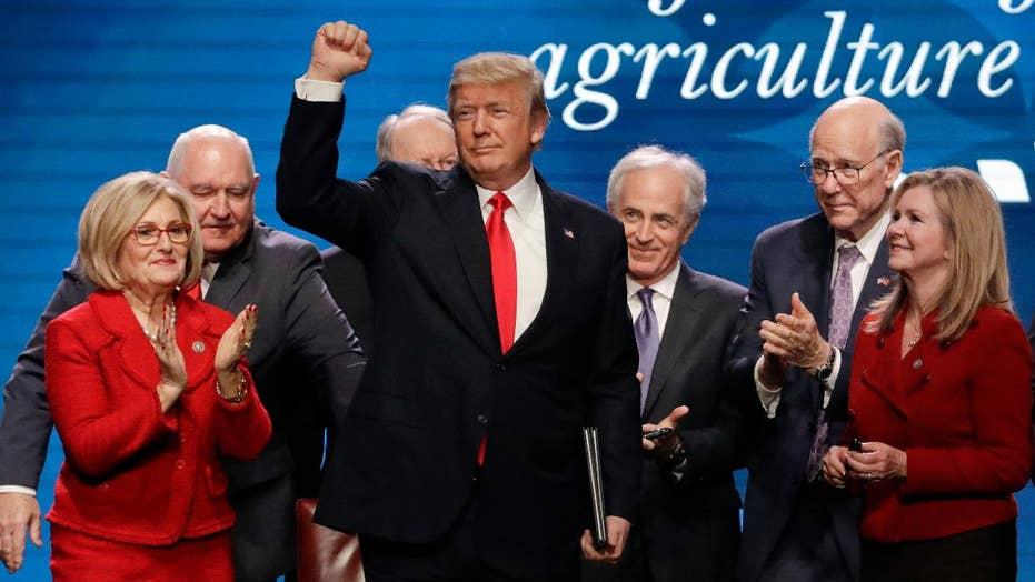 Economy in focus as Trump's critics ramp up attacks