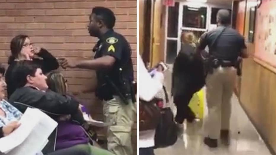 Teacher forcibly removed, arrested at school board meeting
